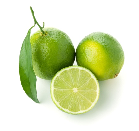 lime slice: Three ripe limes with leafs. Isolated on white Stock Photo