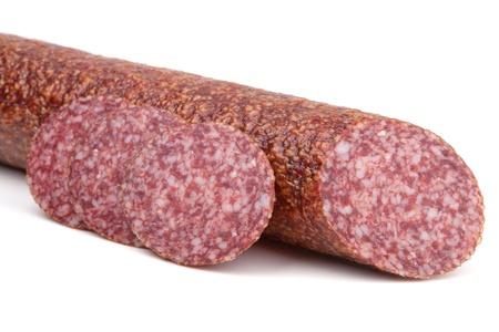 Slices italian salami sausage. Isolated on white background photo