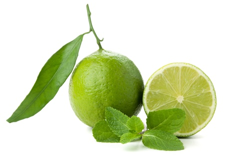 Ripe lime with green leaf and mint. Isolated on white Stock Photo - 8539822