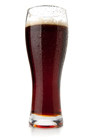 mug of ale: Dark beer with water drops. Isolated on white background Stock Photo