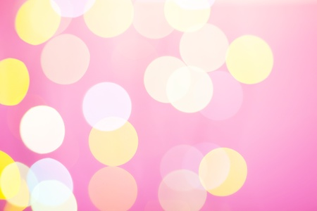 Abstract sunny bokeh on pink background photo