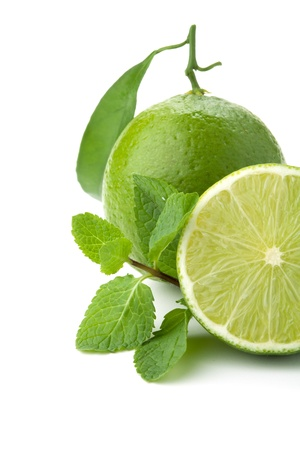 Ripe lime with green leaf and mint. Closeup, isolated on white Stock Photo - 8701426