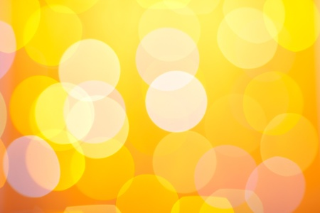 Abstract sunny bokeh on dark yellow background Stock Photo - 8701423