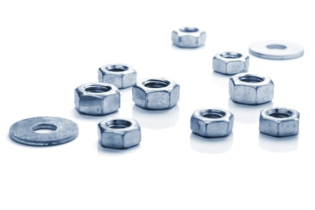 fitted unit: Metal nuts. Isolated on white background. Toned Stock Photo