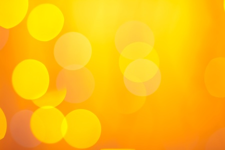yellow shine: Abstract sunny bokeh on orange background Stock Photo