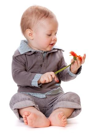 Smiling baby with orange flower. Isolated on white Stock Photo - 8801685