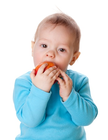 Small baby eating red apple. Isolated on white Stock Photo - 8801684