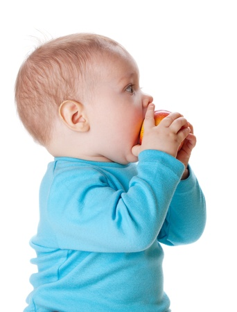 Small baby eating red apple. Isolated on white Stock Photo - 8801770