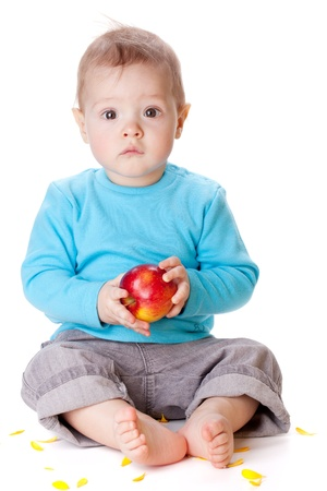 Small baby holding red apple. Isolated on white Stock Photo - 8801790