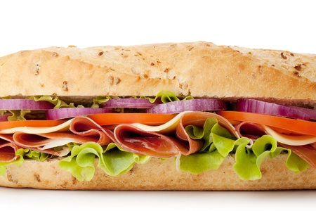 Long sandwich with ham, cheese, tomatoes, red onion and lettuce. Closeup, isolated on white.  photo