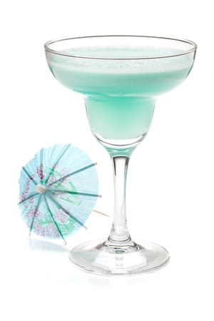 margarita glass: Blue tropical cocktail in margarita glass and umbrella. Isolated on white