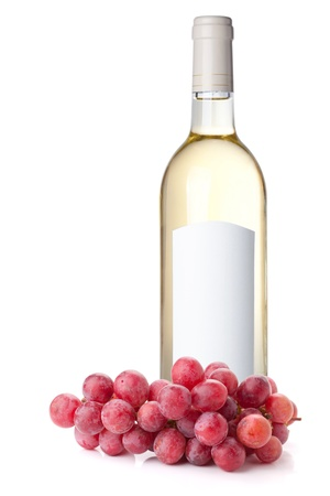 White wine in bottle with blank label and red grapes. Isolated on white background photo