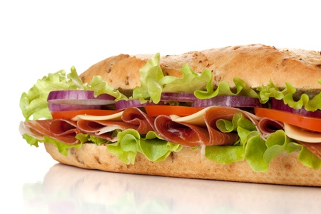 ham sandwich: Long sandwich with ham, cheese, tomatoes, red onion and lettuce. Closeup, isolated on white. Another angle available Stock Photo