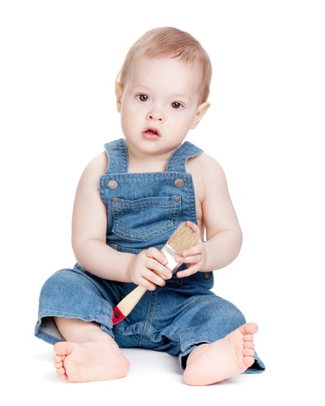 Small baby worker with paint brush. Isolated on white photo