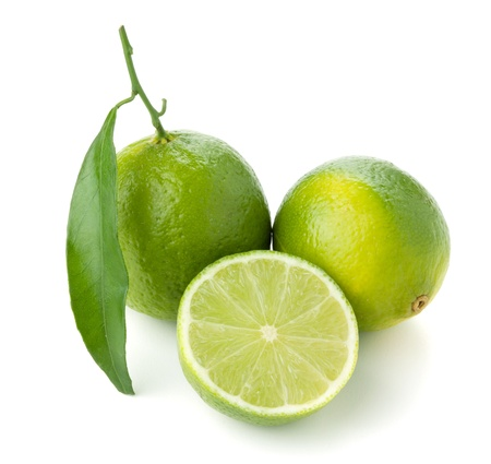 lime slice: Two and half ripe limes. Isolated on white Stock Photo