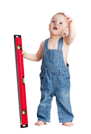 a level: Small baby worker with level. Isolated on white