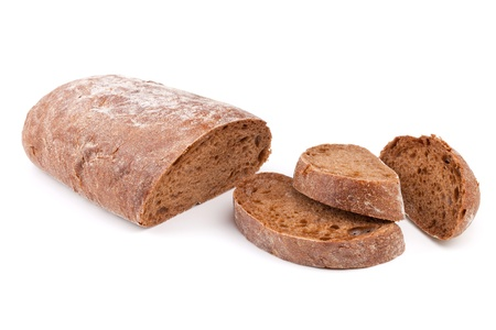 Brown bread with slices. Isolated on white background photo