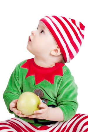 baby in suit: Small baby in santa suit with apple. Closeup, isolated on white Stock Photo