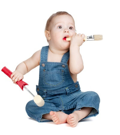 Small baby worker with paint brush and roller. Isolated on white photo