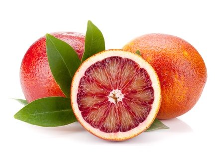 Red oranges with leafs. Isolated on white background Stock Photo - 9294806