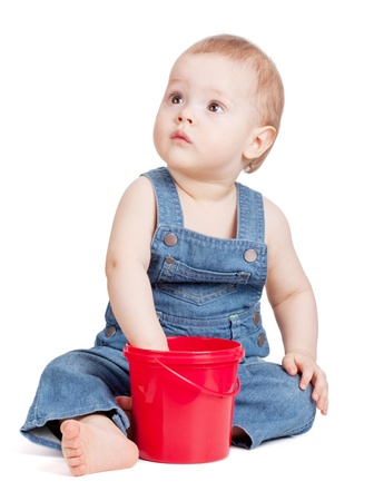 Small baby with toy bucket. Isolated on white Stock Photo - 9349566