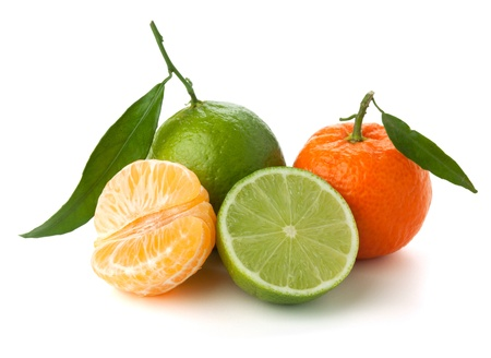 Limes and tangerines. Isolated on white background Stock Photo - 9363551