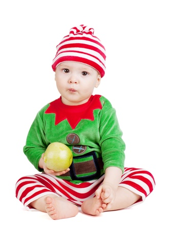 Small baby in santa suit with apple. Isolated on white Stock Photo - 9465392