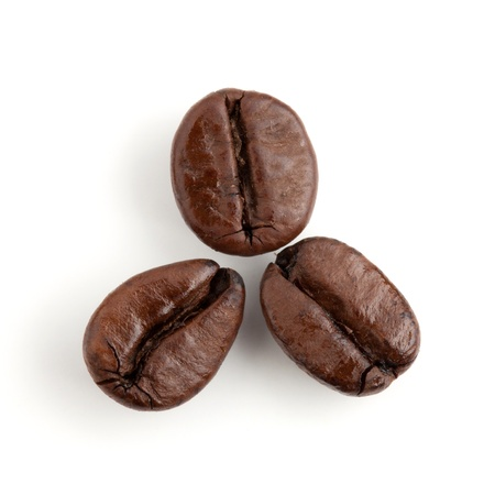 Three coffee beans. Isolated on white background