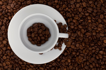 Coffee cup with beans. Above view. On beans background Stock Photo - 9627010
