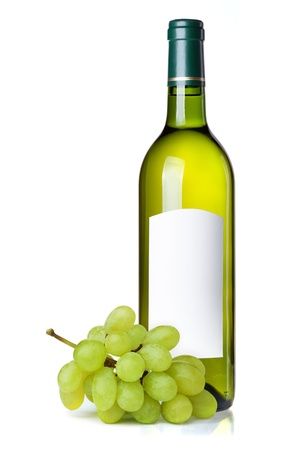 White wine in green bottle with blank label and grapes. Isolated on white background photo