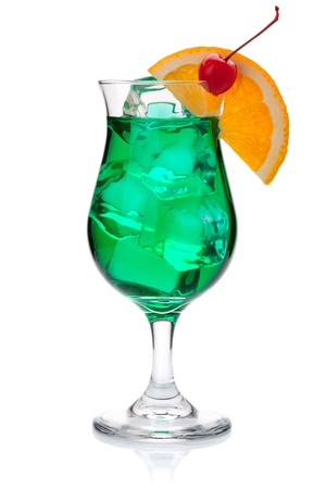 Green tropical cocktail with orange and maraschino. Isolated on white photo