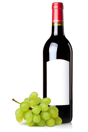 Red wine in bottle with blank label and green grapes branch. Isolated on white background photo