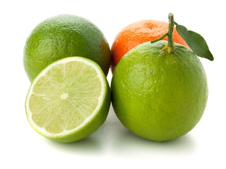 Limes and tangerine. Isolated on white background photo