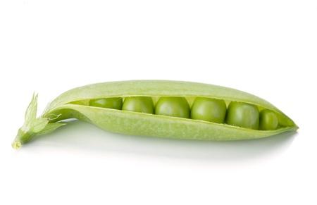 Opened ripe pea vegetable. Isolated on white background photo