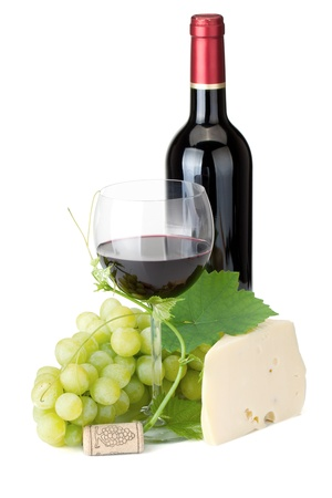 Red wine glass, bottle, cheese and grapes. Isolated on white background photo