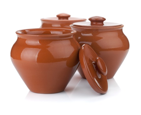 Three clay pots. Isolated on white background photo