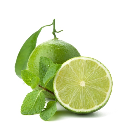 lime juice: Ripe lime with green leaf and mint. Isolated on white Stock Photo