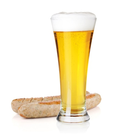 beerglass: Cold light beer in glass and two grilled sausages. Isolated on white background