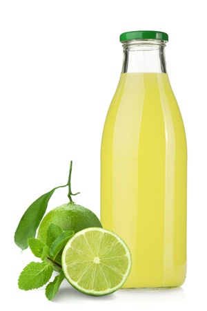 Lemon juice glass bottle, ripe limes and mint. Isolated on white background photo
