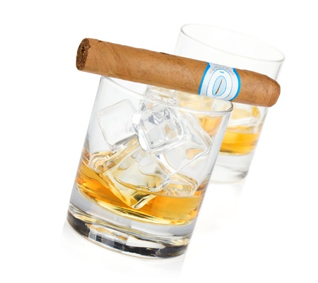 Two whiskey glasses and cigar. Isolated on white background photo