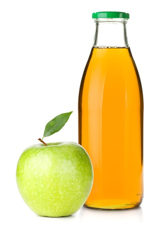 Apple juice in a glass bottle and ripe apple. Isolated on white background photo