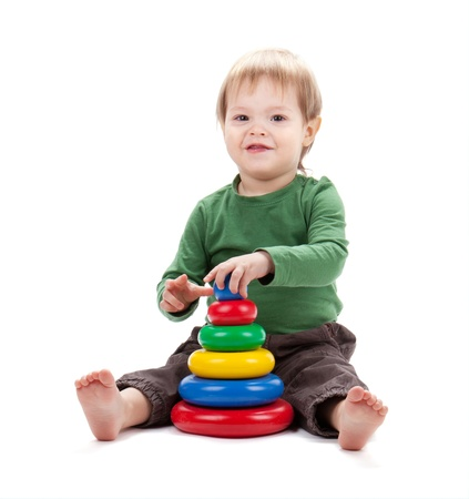 Small baby with a toy pyramid. Isolated on white background Stock Photo - 12780150