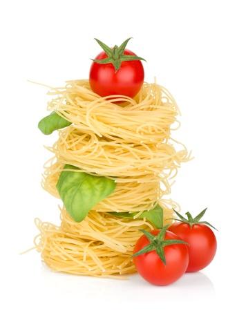 Italian pasta, tomatoes and basil. Isolated on white background