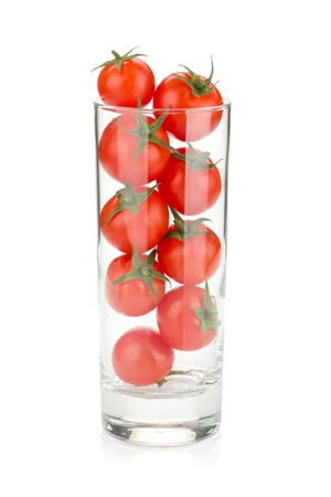 tomato cocktail: Cherry tomatoes in cocktail glass. Isolated on white background