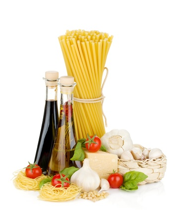 Pasta, tomatoes, basil, olive oil, vinegar, garlic and parmesan cheese. Isolated on white background Stock Photo