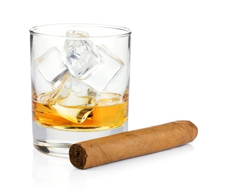 Whiskey glass and cigar. Isolated on white background photo