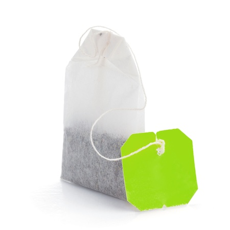 teabag: Teabag with green label. Isolated on white background