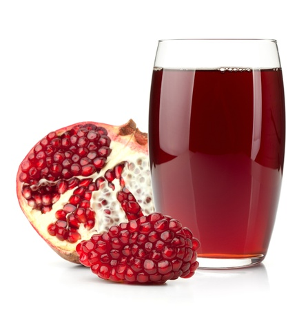 grenadine: Pomegranate juice in a glass and ripe pomegranate. Isolated on white background