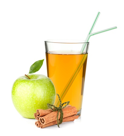 Apple juice in a glass, green apple and cinnamon sticks. Isolated on white background Stock Photo - 13618145