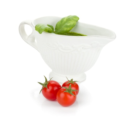 Three cherry tomatoes and pesto sauce. Isolated on white background Stock Photo - 13618107